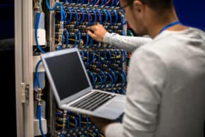 IT Support consultant checking the servers